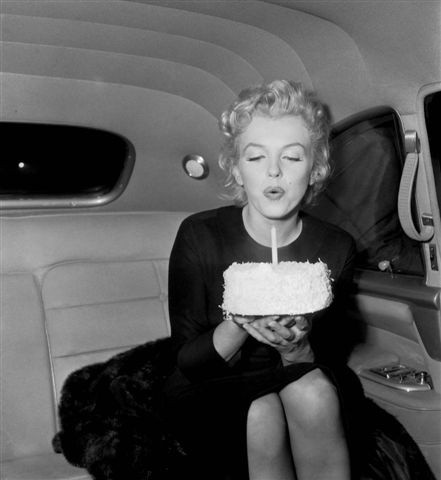 marilyn blowing out candle