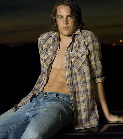riggins is the type of guy who would pose shirtless, on a car. sans grandma.