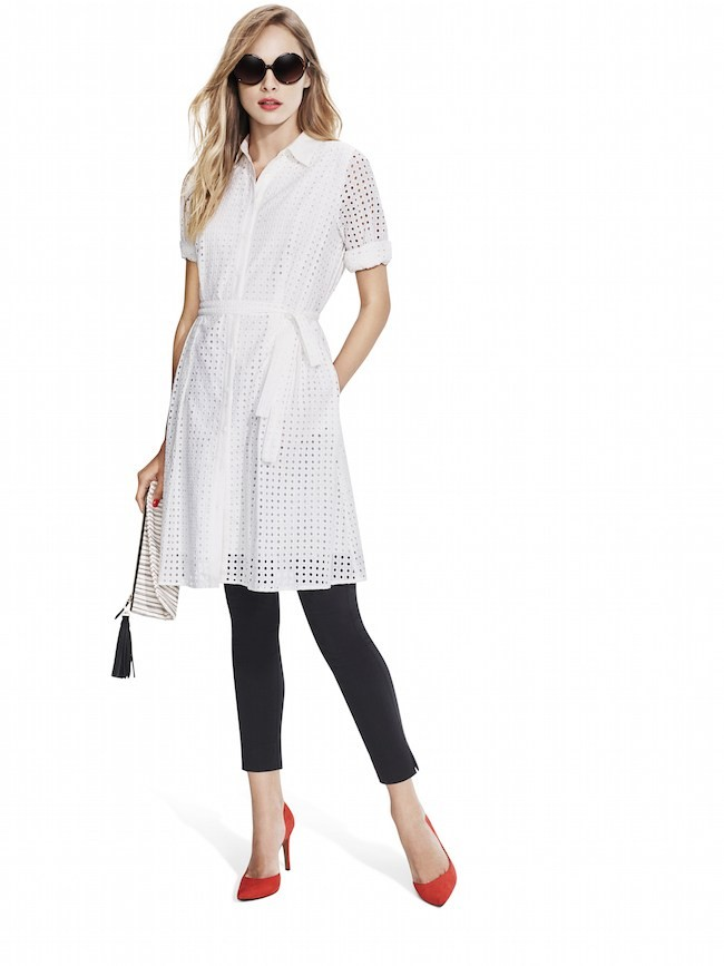 Studio-Model-wearing-white-laser-cut-dot-lace-shirt-dress-with-black-skinny-pants-red-pumps-sunglasses-and-multicolor-fringe-zipper-clutch
